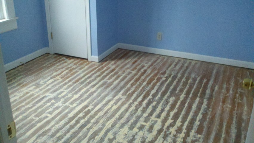 a scratched up and scuffed wood floor