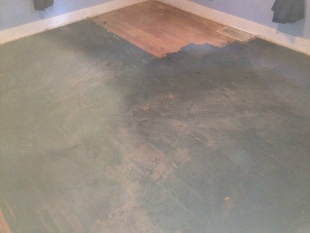 a burnt and damaged hardwood floor