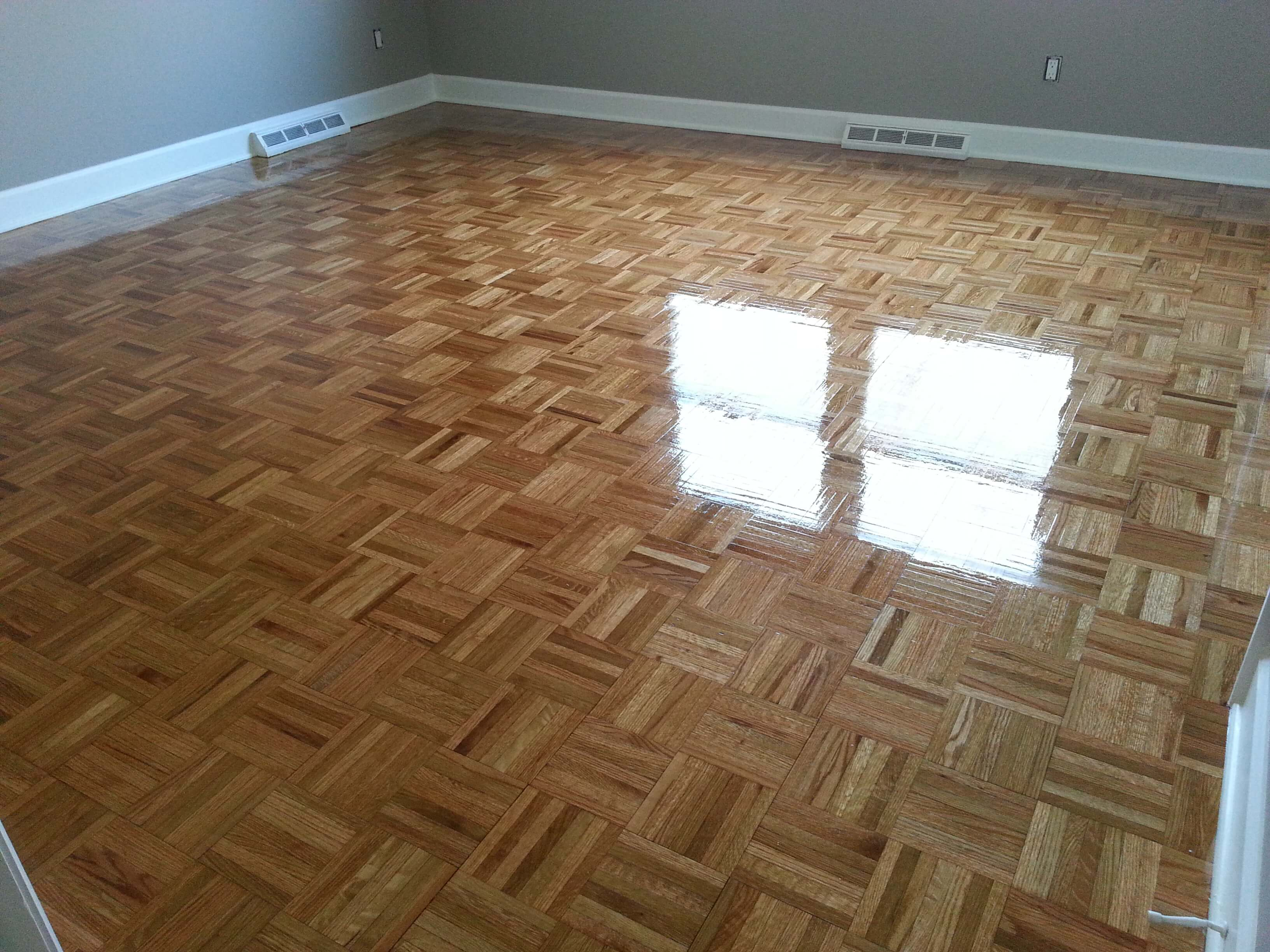 a refinished hardwood floor with a parquet design in Denver