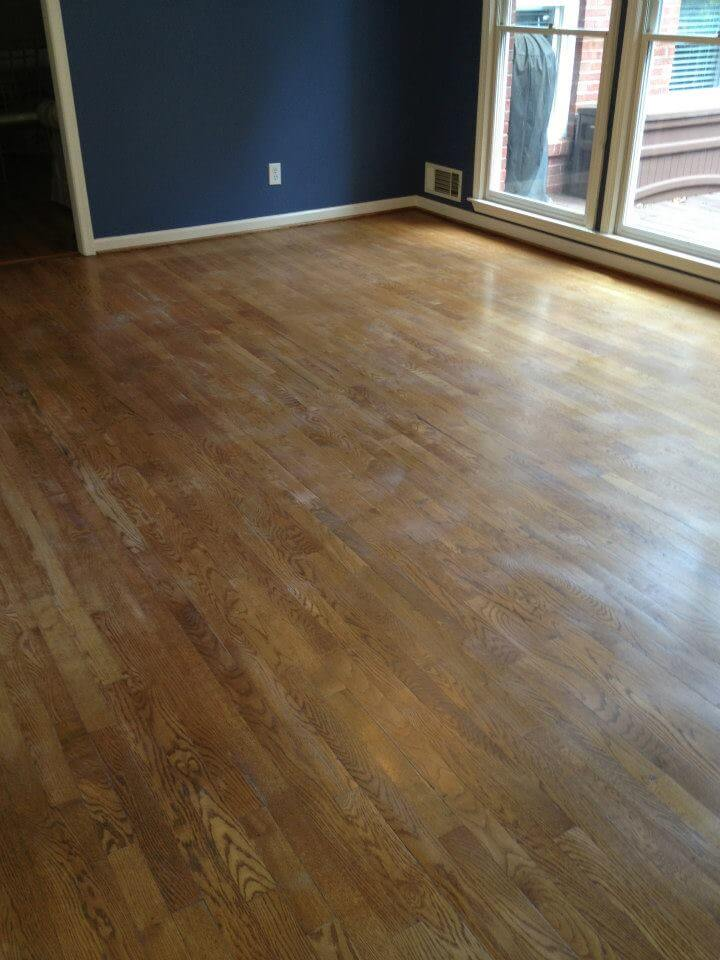 a gently damaged hardwood floor surface