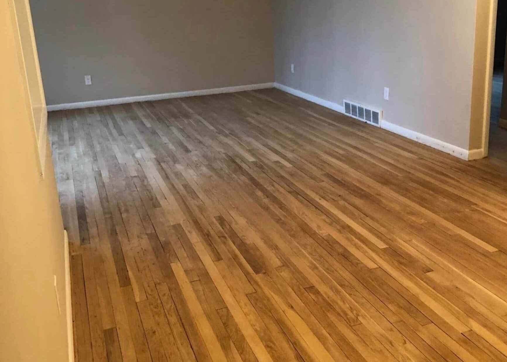 hardwood floor that's been scratched up and has minor damage